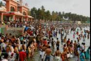 "Devotees offer ""Tarpan"" during Mahalaya at the bank of River Ganga"