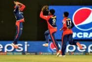 Delhi Daredevils players celebrate the wicket of Manish Panday