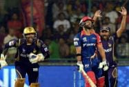 Kolkata Knight Riders players celebrate the wicket of J P Duminy (C) of Delhi Daredevil