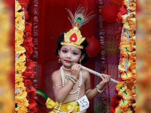 A Child dressed as lord Krishna for a school function