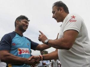 India's cricket team manager Ravi Shastri congratulates to Sri Lankan cricketer Kumar Sangakkara