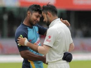 Indian cricket captain Virat Kohli greets Sri Lankan cricketer Kumar Sangakkara