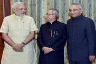 Pranab Mukherjee and Narendra Modi with newly sworn-in Chief Information Commissioner Vijai Sharma