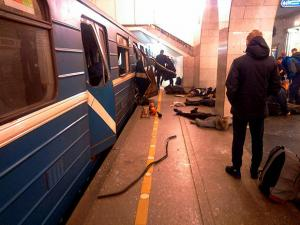 Blast victims lie near a subway train hit by a explosion at the Tekhnologichesky Institut subway station in St.Petersburg