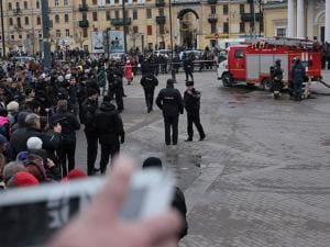 Russian police and emergency service officers block an area next to fire trucks at Sadovaya Square after explosion in St.Petersburg
