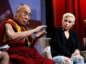 Lady Gaga listens as the Dalai Lama speaks during  U.S. Conference of Mayors in Indianapolis
