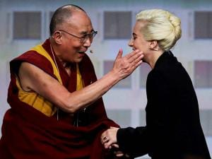 The Dalai Lama greets Lady Gaga, right, before the U.S. Conference of Mayors in Indianapolis