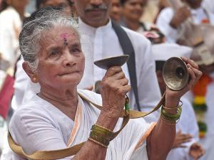 Pilgrims participate in a procession of Lord Vitthal on the occasion of Ashadi Ekadash in Mumbai