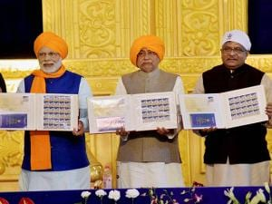 Narendra Modi with Nitish Kumar and Ravishankar Prasad releasing postage stamp