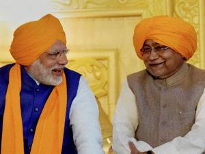 Prime Minister Narendra Modi and Bihar Chief Minister Nitish Kumar share lighter moments