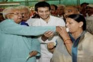 RJD chief Lalu Prasad offers a piece of cake to his wife Rabri Devi