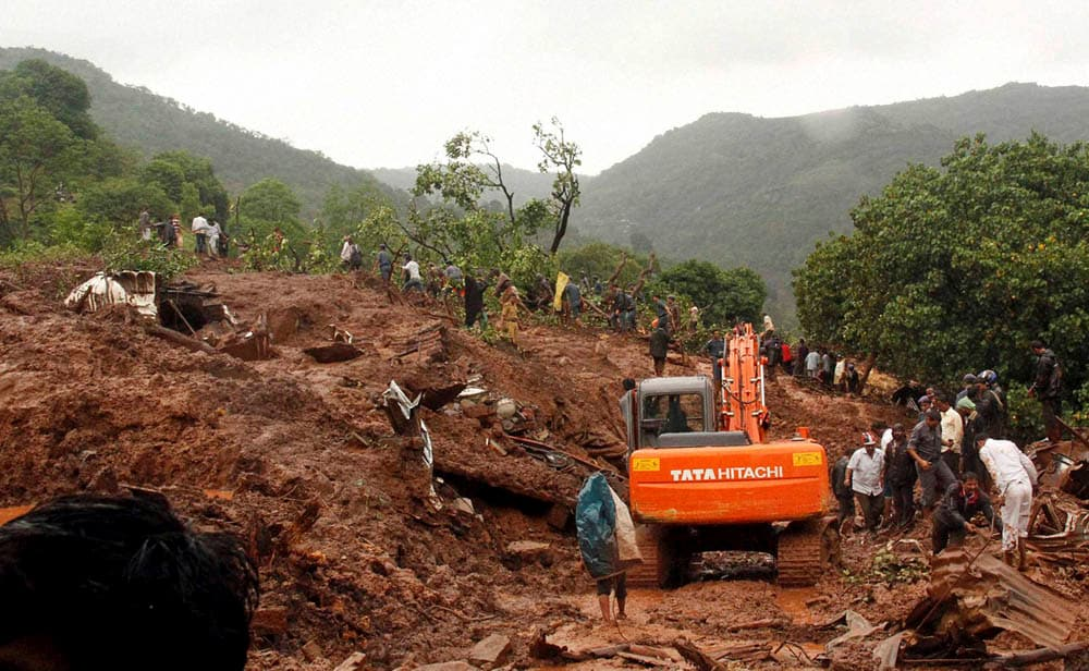 Rescue, workers, carry, body, victim, landslide, Malin village,  Maharashtra