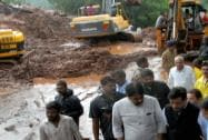 Maharashtra Chief Minister Prithviraj Chavan visits the site of a landslide in Malin village