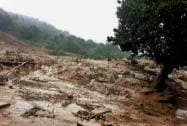 The debris of a hillock after a landslide triggered by heavy rains at Malin village in Pune district