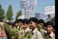 "BSF recruits holding saplings and placards during the launch of a plantation drive ""My Earth My Duty – Pan India Plantation"""