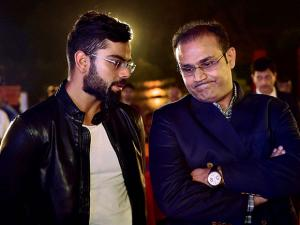 Virat Kohli and former team matevirender sehwag share a moment at the book launch of Virat Kohli's biography, 'Driven'  in New Delhi