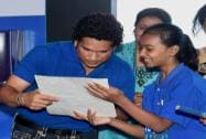 """Cricket legend Sachin Tendulkar with student at the launch of the campaign """"Shuddh Paani, Swastha Bharat"""""""