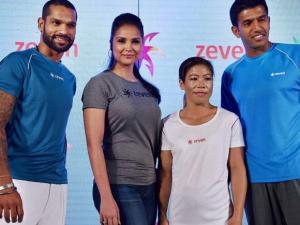 Sikhar Dhawan, Lara Dutta,  boxing star Mary Kom and Rohan Bopanna pose for photographs during the launch of Zeven sports brand in New Delhi
