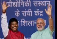 Prime Minister Narendra Modi with BJP leader Arjun Munda