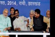 Prime Minister Narendra Modi with Jharkhand CM Hemant Soren and Oil Minister Dharmendra Pradhan