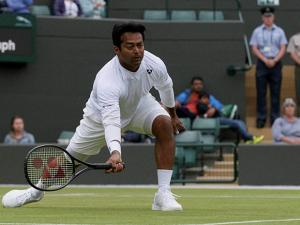 Leander Paes of India plays a return during his mixed double match