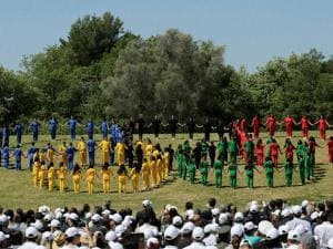 Youths form the Olympic Rings during the ceremonial lighting of the Olympic flame in Ancient Olympia, Greece