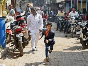 Actor Sunny Pawar runs as he arrives to attend a press meet in Mumbai