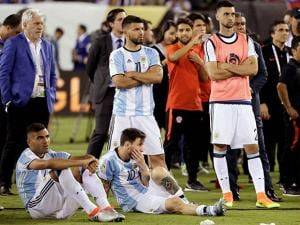 Argentina's Lionel Messi (10) waits with his teammates for trophy presentations after the Copa America 2016