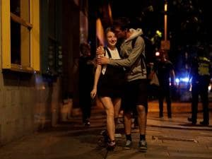 A man kisses a woman about 10 minutes after midnight a they walk away from inside a police cordon after an attack in London
