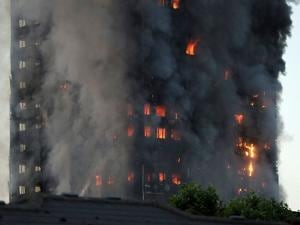 flames rise from building on fire in London