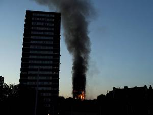 Smoke and flames rise from a building on fire in London