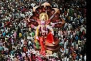 An idol of Lord Ganesha being taken for immersion on the final day of Ganpati festival