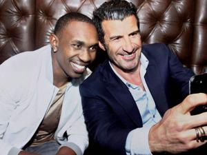 Portuguese football legend Luís Figo taking a selfie with West Indies all rounder Dwayne Bravo at a function in Chennai.
