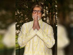 Amitabh Bachchan gestures during a press conference on his 74th birthday in Mumbai