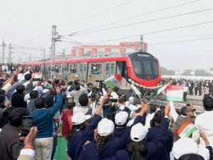 People flag-off the trial run of Lucknow Metro in Lucknow