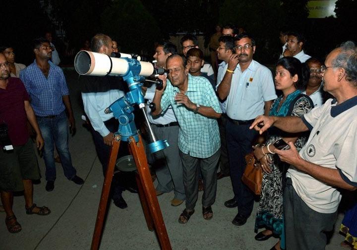 People, watching, lunar eclipse, through, telescope, Guwahati planetarium