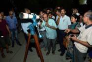 People watching lunar eclipse through a telescope at Guwahati planetarium