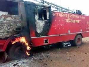 A fire tender that was was torched by the farmers