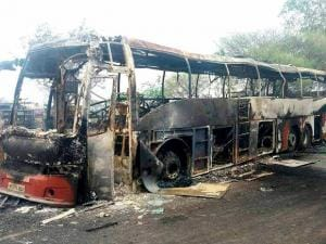 The chartered buses after being torched by the agitating farmers