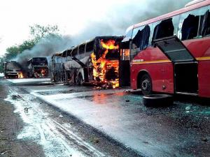 The chartered buses after being torched by the agitating farmers at Bhopal-Indore highway