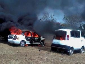 Vehicles in flames after being torched by the agitating farmers