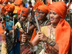 People take part in a Maharashtra day rally in Mumbai