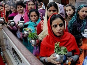 Devotees standing in queues to pay obeisance at a Shiv Temple on the occasion of Mahashivratri in Amritsar