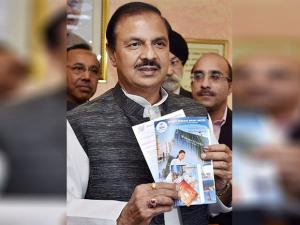 Mahesh Sharma launching the presentation of Pre-Loaded Free SIM Cards for foreign tourists arriving in India