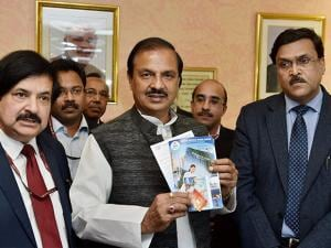 Minister of State for Tourism & Culture Mahesh Sharma with Secretary, Telecom, J S Deepak and Secretary, Tourism, Vinod Zutshi