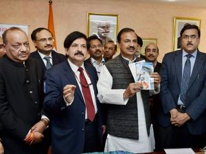 Minister of State (IC) for Tourism & Culture,Mahesh Sharma launching the presentation of Pre loaded Free SIM Cards for foreign tourists