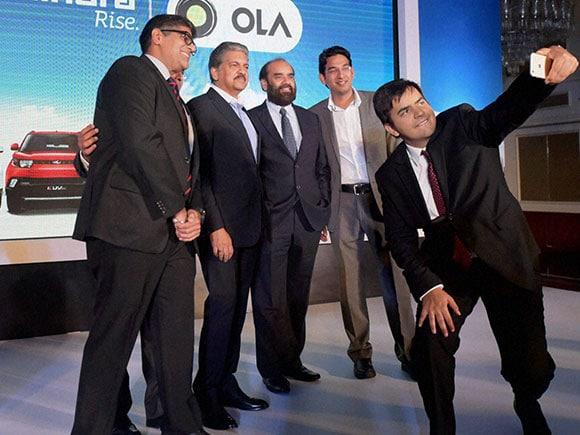 Ola, Mahindra Group, Anand Mahindra, Bhavish Aggarwal, Ola Cab, Ola cab services