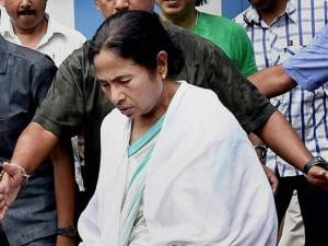 Escorted by her security personnel West Bengal CM Mamata Banerjee walks out of her residence after her party's thumping win in West Bengal Assembly election