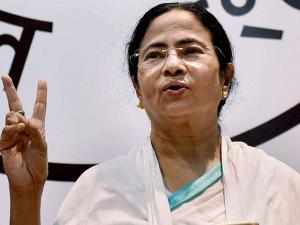 West Bengal CM Mamata Banerjee flashes victory sign after her party's thumping win in West Bengal Assembly elections