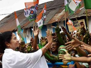 West Bengal CM Mamata Banerjee shaking hands with supporters after her party's thumping win in West Bengal Assembly elections, in Kolkata
